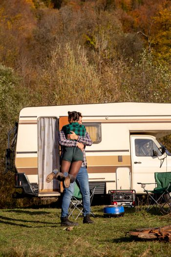 Beautiful young couple having a romantic camping site in the mou