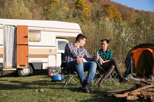 Couple enjoying their holiday in a mountain camps site