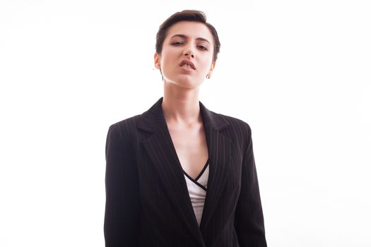 Portraif of fashion model in her 20s wearing a black jacket in studio over white background