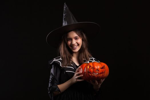 Cute little girl with a evil laugh doing sorcery with a pumpking