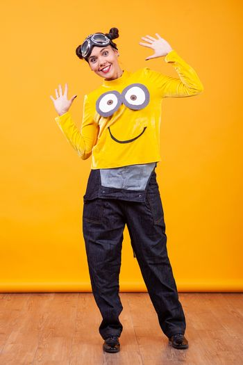 Beautiful young woman wearing funny minion pullover