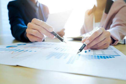Startups business teamwork meeting analyse marketing data.