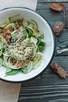 Healthy tasty vegan salad in white plate