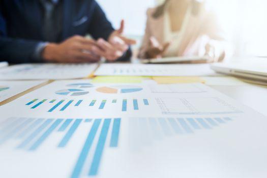 Startups business teamwork meeting to analyse marketing data