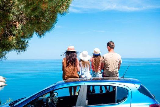 Family travel by the car and have stop by the sea