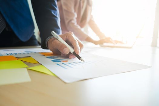 Startups business teamwork meeting to analyse marketing data.