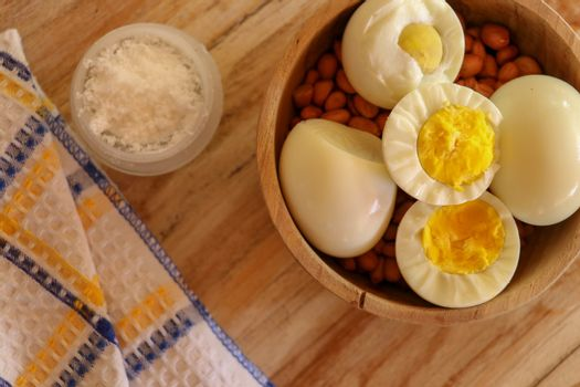 Boiled egg on a wooden background. Kind from above.