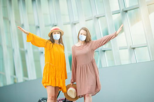 Young tourist women with baggage in international airport