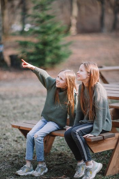 Little girls in outdoor park on her weekend