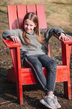 Little girl in outdoor park on her weekend