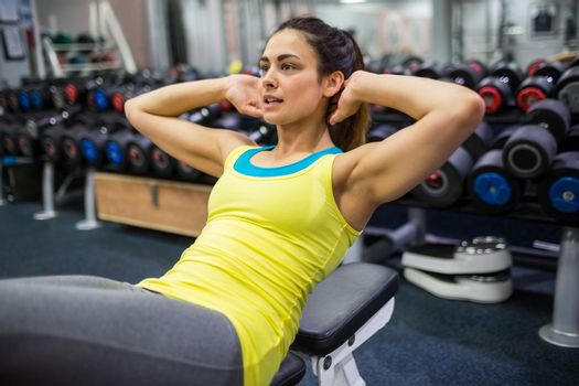 Determined woman doing sit ups