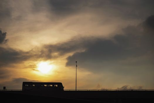 Silhouette bus on the expressway with sunset