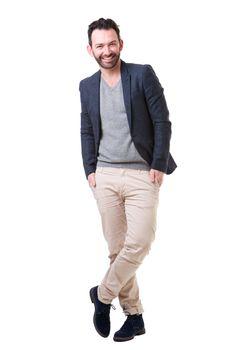 Full body handsome man with beard posing against white background