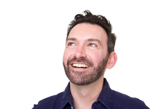 Close up of happy man with beard looking up