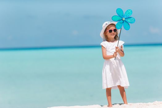 Back view of little girl at beach during summer vacation
