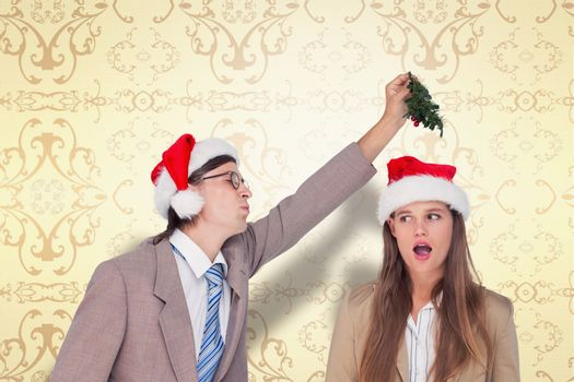 Composite image of geeky hipster with mistletoe