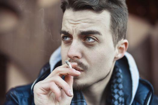 Man smoking cigarette Close up of an smoking cigarette