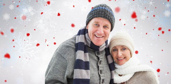 Mature winter couple against snowflake pattern