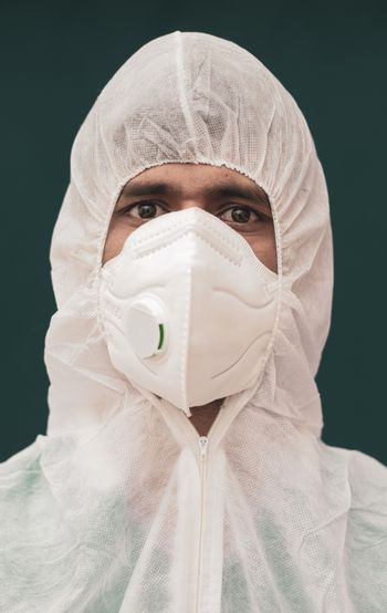 Close up portrait of doctor with protective suite and medical N95 Face Mask - concept of doctors at coronavirus or covid-19 screening process .