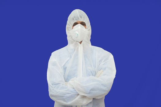 Confident epidemiologist in hazmat suit with medical face mask - Concept to fight covid-19 or coronavirus outbreak by controlling virus spread