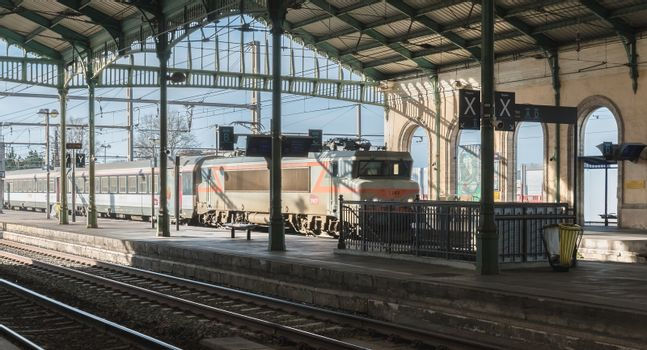 Sete, France - January 4, 2019: train entering in the city train station on a winter day