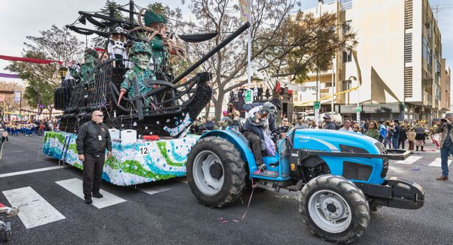 Loule, Portugal - February 25, 2020: Float parading in the street in front of the public in the parade of the traditional carnival of Loule city on a February day
