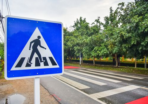 Crosswalk sign on the road for safety when people walking the st