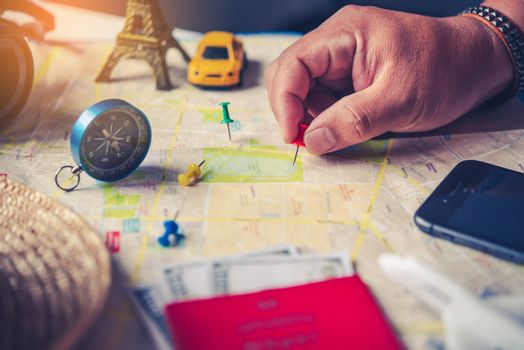 Travelers are planning a trip by searching the route on the map
