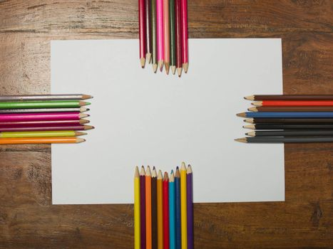various colors of pencils on a white background, copy space