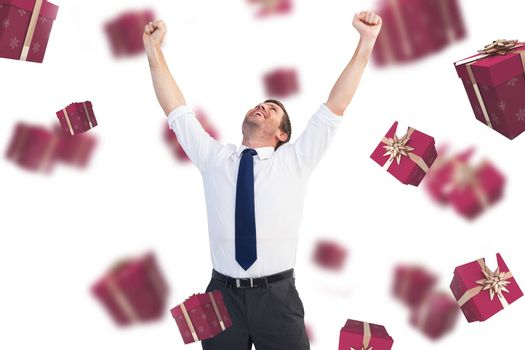 Cheering businessman against red presents