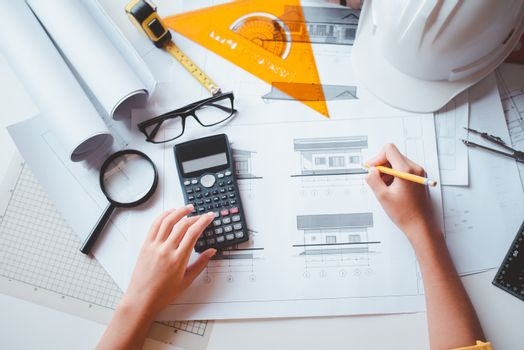 engineer working in office with blueprints, inspection in workp