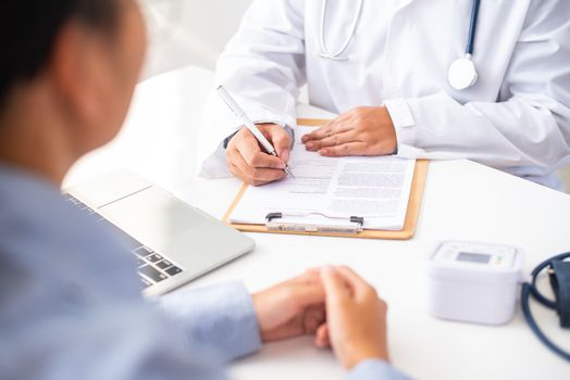 The doctor is discussing with the patient after a physical exami