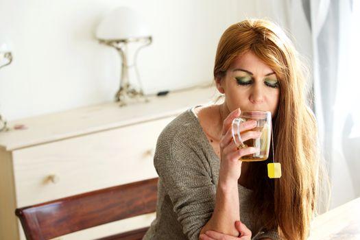Beautiful woman having refreshing tea