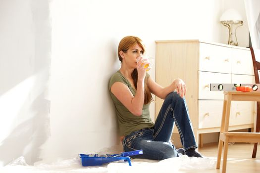 Woman taking a break from home renovation