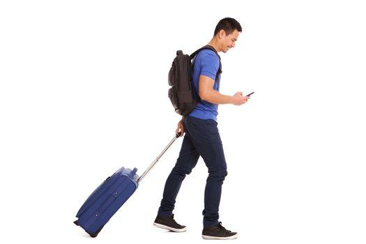 Mature traveler with phone