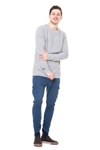 Full body handsome young man against against isolated white background