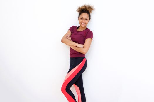 beautiful african american woman smiling with sports clothing