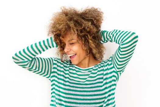 happy young black woman laughing with hand in hair
