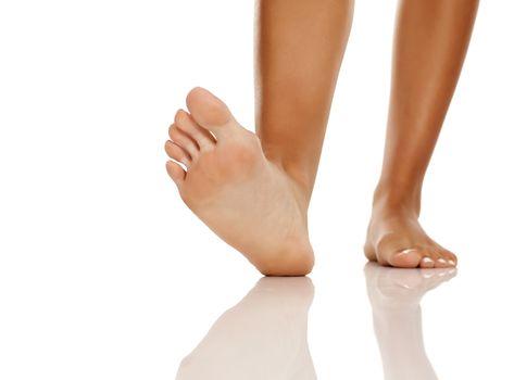 Beautiful Womens Feet On White Background