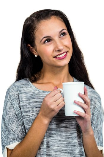 Day dreaming woman holding white cup