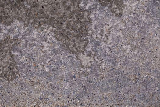 wet sand covers concrete