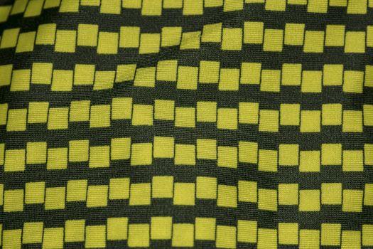 black and yellow fabric, closeup on pattern