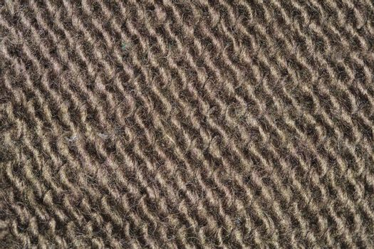 brown fabric texture, closeup on stitch