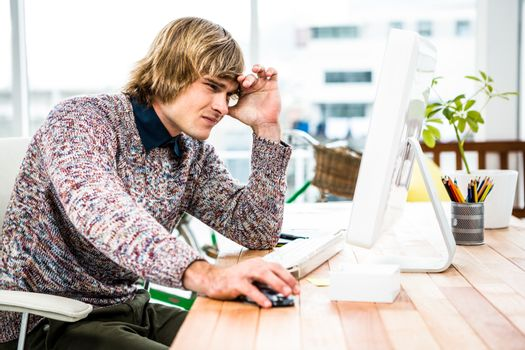 Troubled hipster businessman sitting in his office