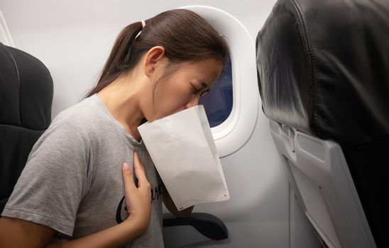female passenger on the plane felt airsick, affected with nausea