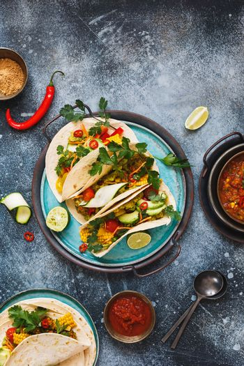 Healthy vegan tacos made with with lentils, pico de gallo sauce,  vegetables, avocado and guacamole, ready to eat. Top view, blank space
