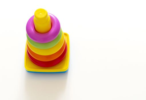 Colorful plastic ring tower for kids seen from above. Childhood and creativity