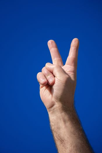 An image of a male hand V sign