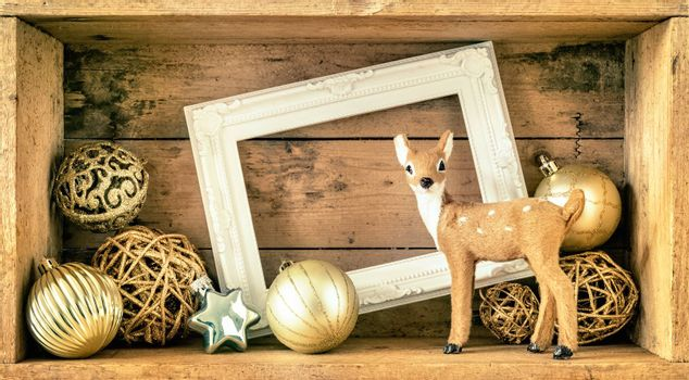 Christmas decoration wooden box with deer golden balls and a whi