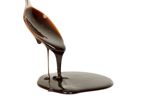 chocolate syrup dripping from spoon